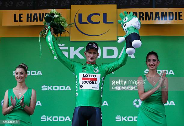 Andre Greipel of Germany and LottoSoudal celebrates as he is awarded the green jersey on the podium after stage six of the 2015 Tour de France a...