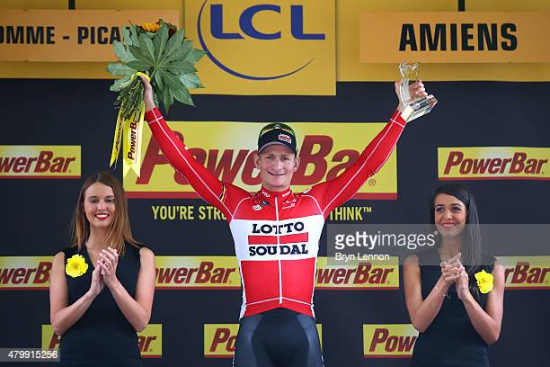 Andre Greipel of Germany and LottoSoudal celebrates on the podium following his victory during stage five of the 2015 Tour de France a 1895km stage...
