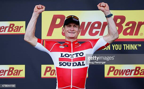 Andre Greipel of Germany and LottoSoudal celebrates the stage victory on the podium after stage two of the 2015 Tour de France a 166km stage between...