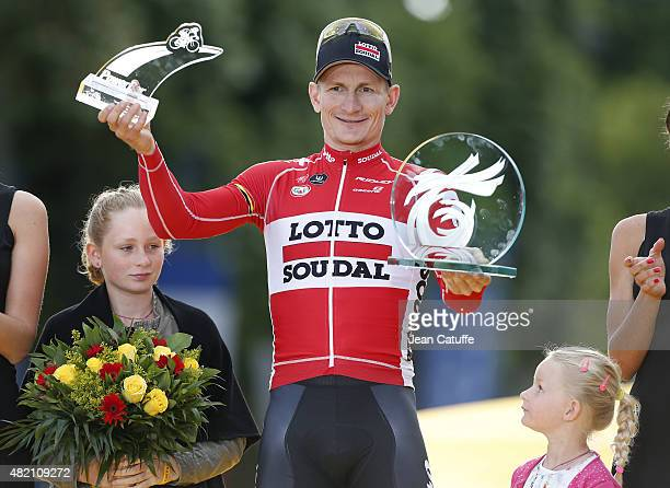 Andre Greipel of Germany and LottoSoudal celebrates with his daughters winning stage twenty one of the 2015 Tour de France a 1095 km stage from...