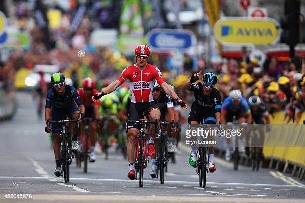 Andre Greipel of Germany and LottoSoudal claims victory on the finish line of stage eight of the Tour of Britain an 868km stage around central London...