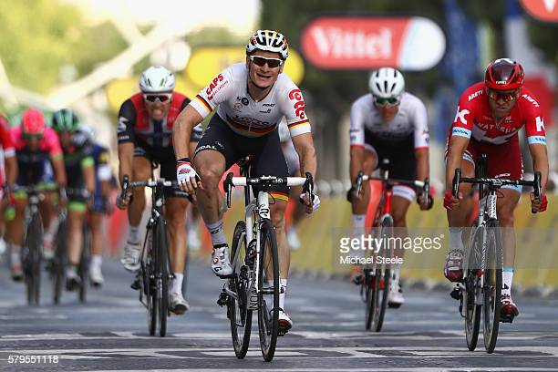 Andre Greipel of Germany and LottoSoudal croses the finish line to win stage twenty one of the 2016 Le Tour de France from Chantilly to Paris...