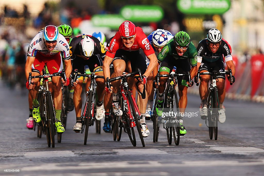 Andre Greipel (C) of Germany and Lotto-Soudal leads the bunch sprint to the finish line to win the twenty first stage of the 2015 Tour de France, a 109.5 km stage between Sevres and Paris Champs-Elysees, on July 26, 2015 in Paris, France.