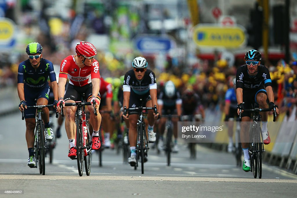 Andre Greipel of Germany and LottoSoudal looks over at Elia Viviani of Italy and Team SKY after claiming victory on the finish line of stage eight of...