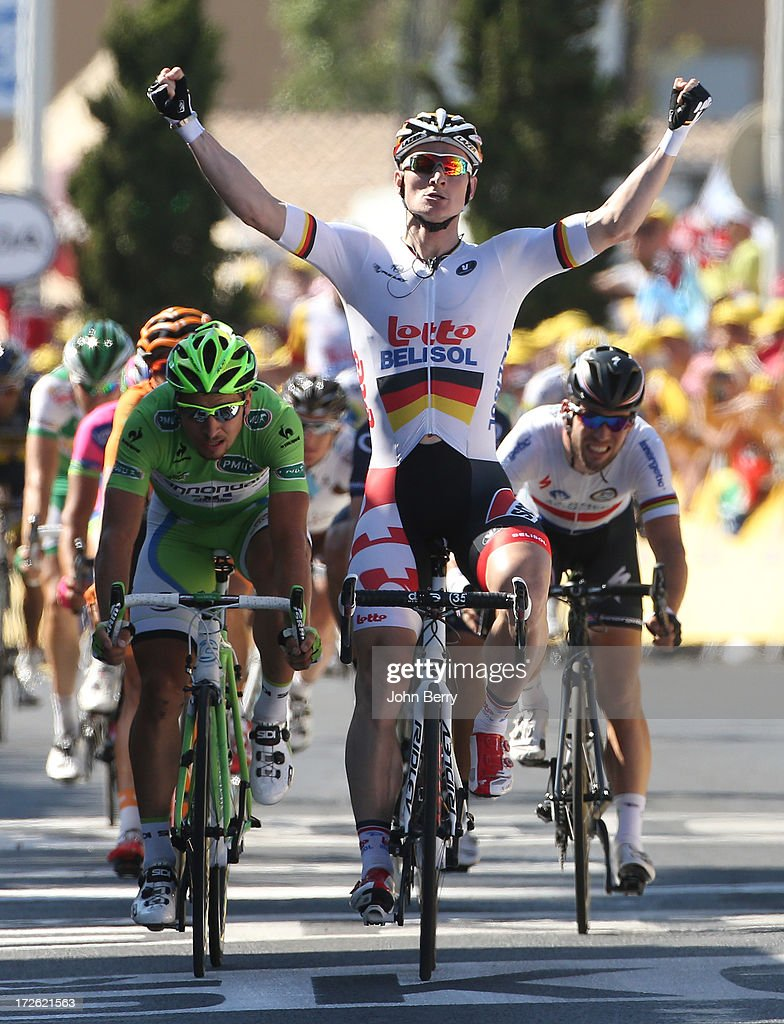 <a gi-track='captionPersonalityLinkClicked' href=/galleries/search?phrase=Andre+Greipel&family=editorial&specificpeople=874849 ng-click='$event.stopPropagation()'>Andre Greipel</a> of Germany and Team Lotto Belisol leads <a gi-track='captionPersonalityLinkClicked' href=/galleries/search?phrase=Peter+Sagan&family=editorial&specificpeople=4846179 ng-click='$event.stopPropagation()'>Peter Sagan</a> of Slovakia and Team Cannondale, <a gi-track='captionPersonalityLinkClicked' href=/galleries/search?phrase=Mark+Cavendish&family=editorial&specificpeople=684957 ng-click='$event.stopPropagation()'>Mark Cavendish</a> of Great Britain and Team Omega Pharma Quick-Step to win Stage Six of the Tour de France 2013 - the 100th Tour de France -, a 176 km road stage from Aix-en-Provence to Montpellier on July 4, 2013 in Montpellier, France.