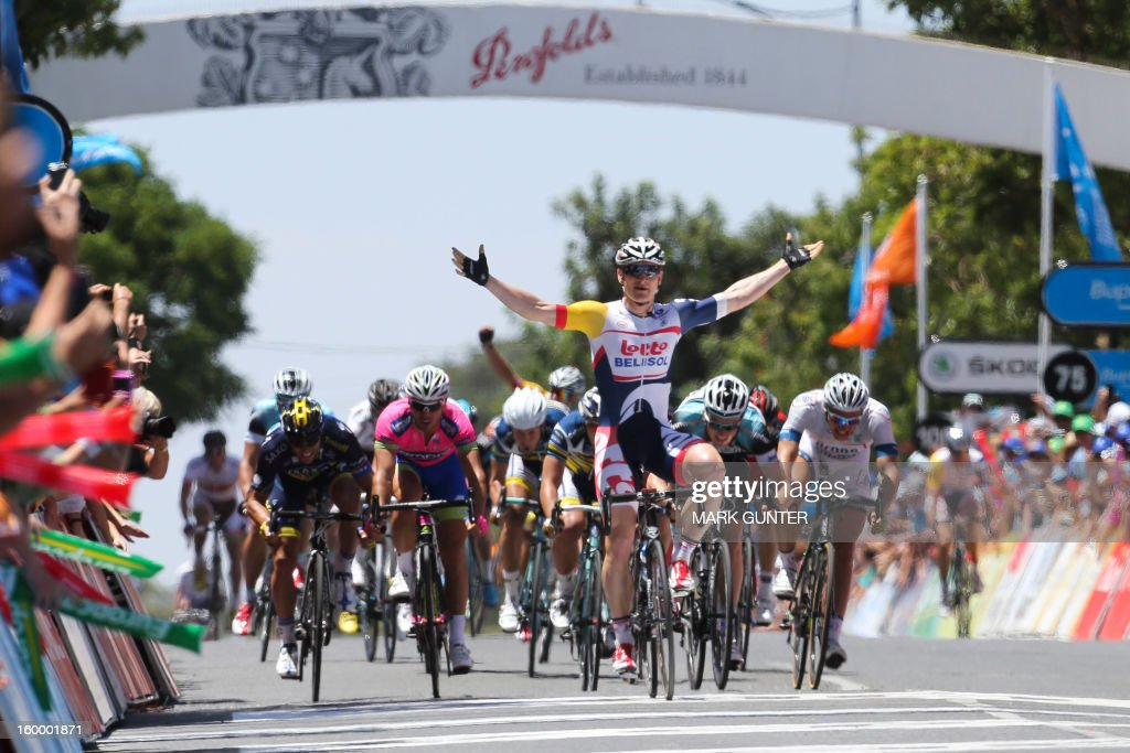 Andre Greipel (C) of Germany reacts as he wins the 126.5km stage 4 of the Tour Down Under in Adelaide on January 25, 2013. The six-stage Tour Down Under takes place from January 20 to 27. AFP PHOTO / Mark Gunter IMAGE STRICTLY RESTRICTED TO EDITORIAL USE - STRICTLY NO COMMERCIAL USE