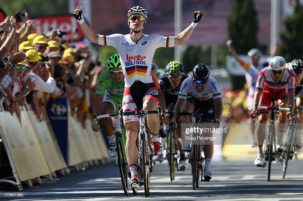 <a gi-track='captionPersonalityLinkClicked' href=/galleries/search?phrase=Andre+Greipel&family=editorial&specificpeople=874849 ng-click='$event.stopPropagation()'>Andre Greipel</a> of Germany riding for Lotto-Belisol celebrates as he crosses the finish line to win stage six of the 2013 Tour de France, a 176.5KM road stage from Aix-en-Provence to Montpellier, on July 4, 2013 in Montpellier, France.