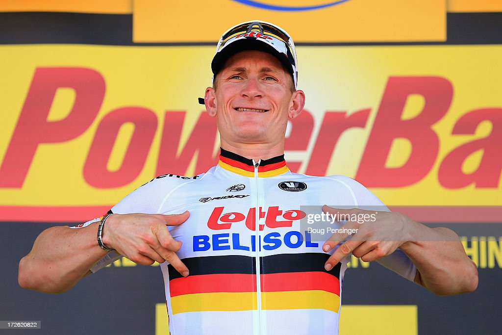 <a gi-track='captionPersonalityLinkClicked' href=/galleries/search?phrase=Andre+Greipel&family=editorial&specificpeople=874849 ng-click='$event.stopPropagation()'>Andre Greipel</a> of Germany riding for Lotto-Belisol celebrates on the podium after winning stage six of the 2013 Tour de France, a 176.5KM road stage from Aix-en-Provence to Montpellier, on July 4, 2013 in Montpellier, France.