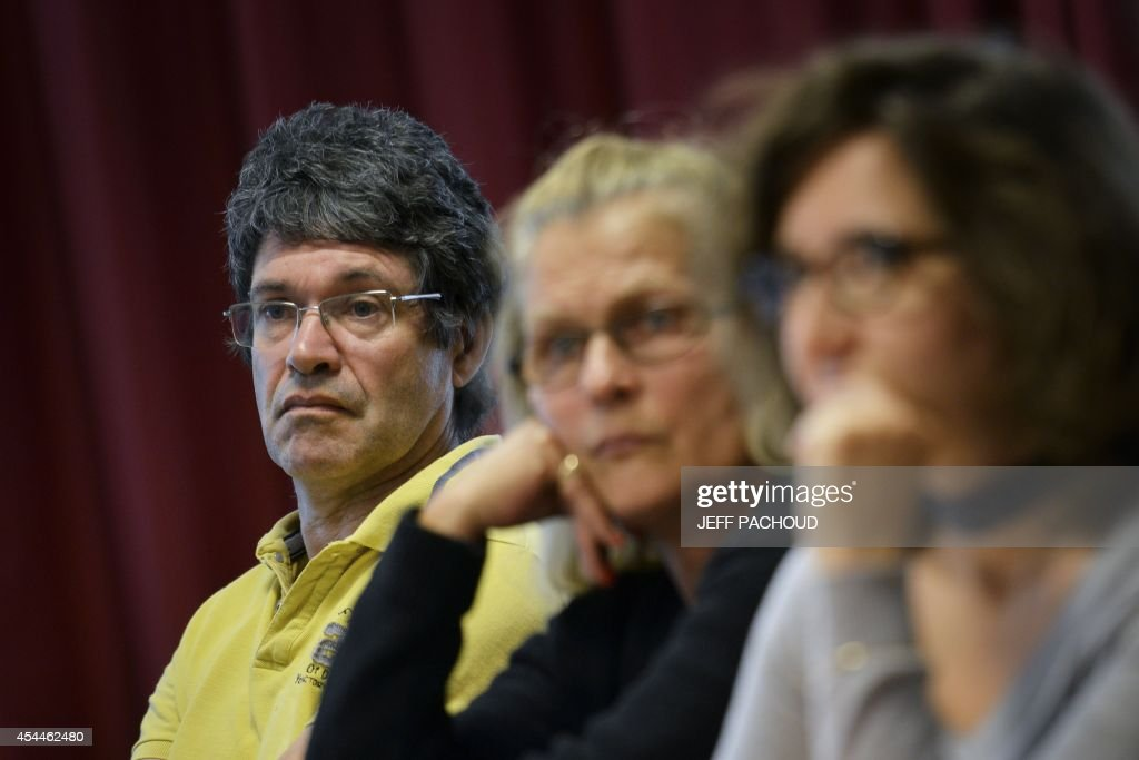 Andre Gros-Coissy (L), the father of Aurore Gros-Coissy, a woman held in dentention in Mauricius for drug traffic, on September 1, 2014, in Lyon, during press conference held on the eve of the start of her daughter's trial. Aurore Seline Gros-Coissy was arrested on August 2011 after Mauritian police found in her luggage 1680 pills of Subutex, a substitute for heroin considered a hard drug there. She claims to have carried the pills unknowingly, trapped by her ex-friend. AFP PHOTO / JEFF PACHOUD