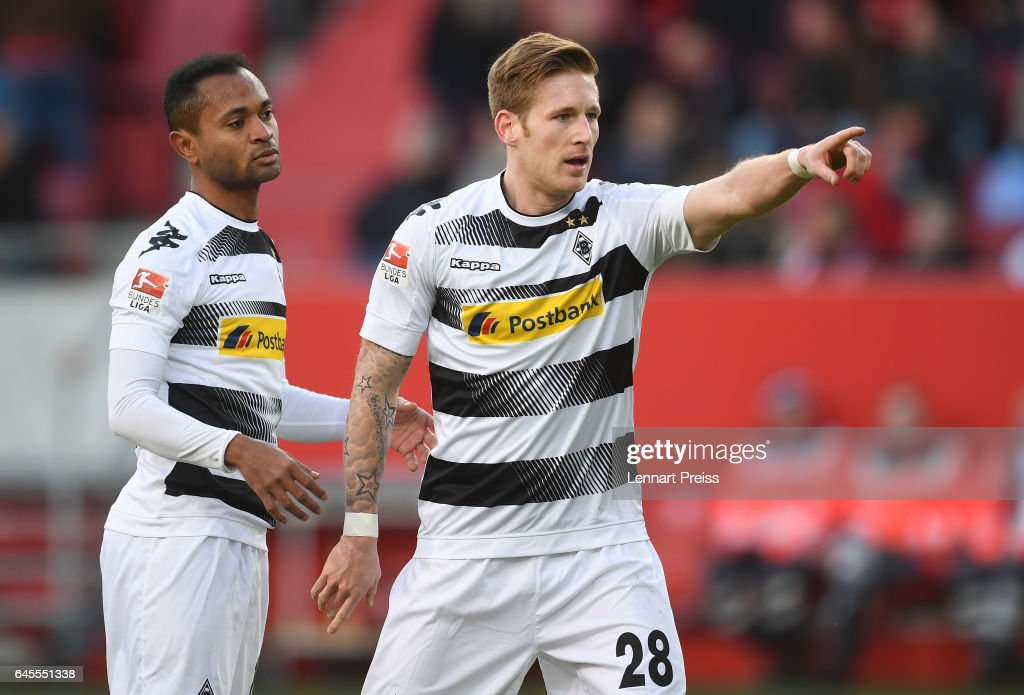Andre Hahn (R) and Raffael of Borussia Moenchengladbach celebrate their side's second goal during the Bundesliga match between FC Ingolstadt 04 and Borussia Moenchengladbach at Audi Sportpark on February 25, 2017 in Ingolstadt, Germany.