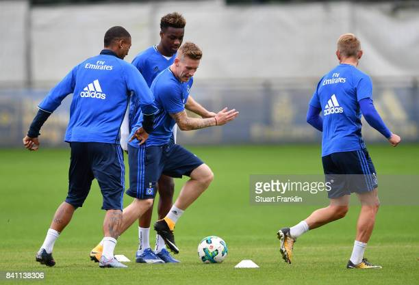 Andre Hahn controls the ball from Walace during a training session of Hamburger SV on August 31 2017 in Hamburg Germany
