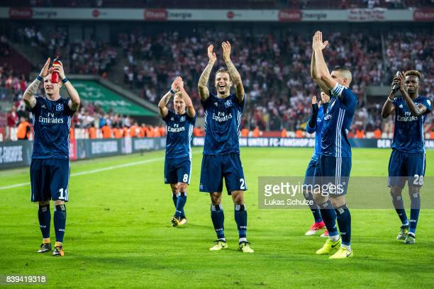 Andre Hahn Lewis Holtby Dennis Diekmeier Kyriakos Papadopulos and Gideon Jung celebrate their win with their fans after the Bundesliga match between...