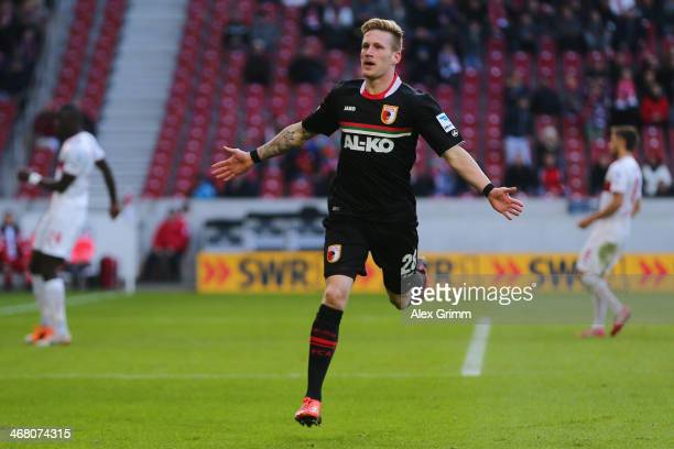 Andre Hahn of Augsburg celebrates his team's third goal during the Bundesliga match between VfB Stuttgart and FC Augsburg at MercedesBenz Arena on...