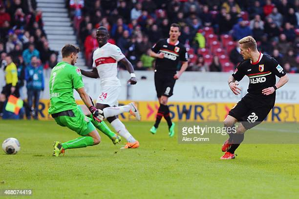 Andre Hahn of Augsburg scores his team's third goal against goalkeeper Sven Ulreich of Stuttgart during the Bundesliga match between VfB Stuttgart...