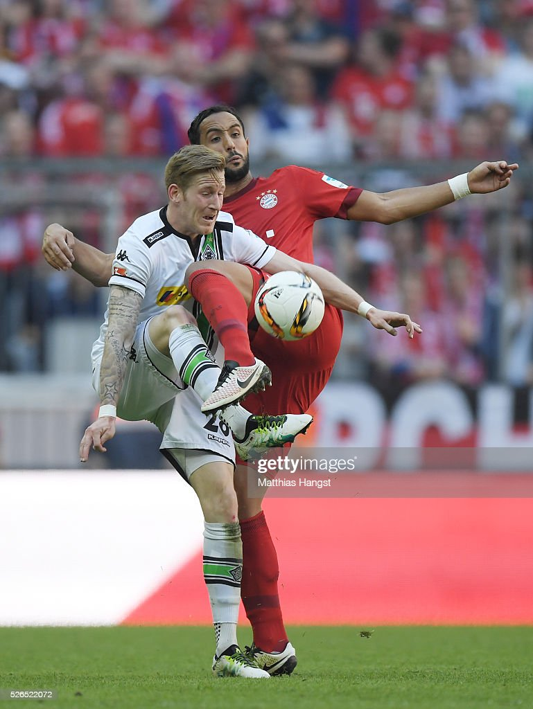 Andre Hahn of Borussia Moenchengladbach and Medhi Benatia of Bayern Muenchen compete for the ball during the Bundesliga match between Bayern Muenchen and Borussia Moenchengladbach at Allianz Arena on April 30, 2016 in Munich, Germany.
