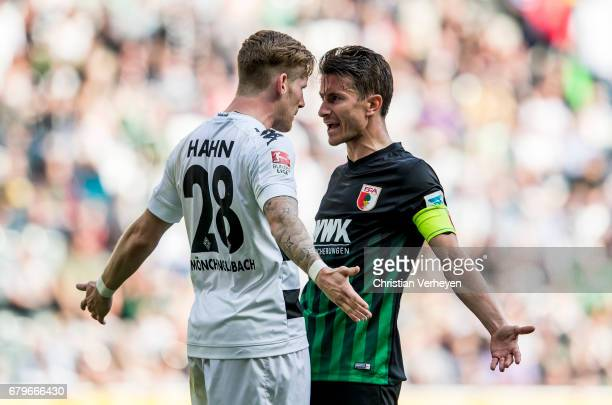 Andre Hahn of Borussia Moenchengladbach and Paul Verhaegh of FC Augsburg look angry during the Bundesliga Match between Borussia Moenchengladbach and...
