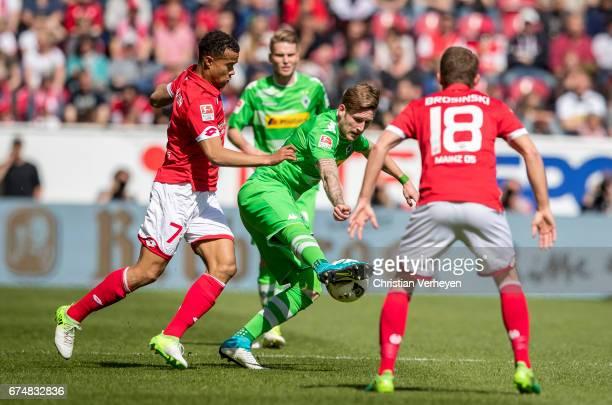 Andre Hahn of Borussia Moenchengladbach and Robin Quaison of FSV Mainz 05 battle for the ball during the Bundesliga Match between 1FSV Mainz 05 and...