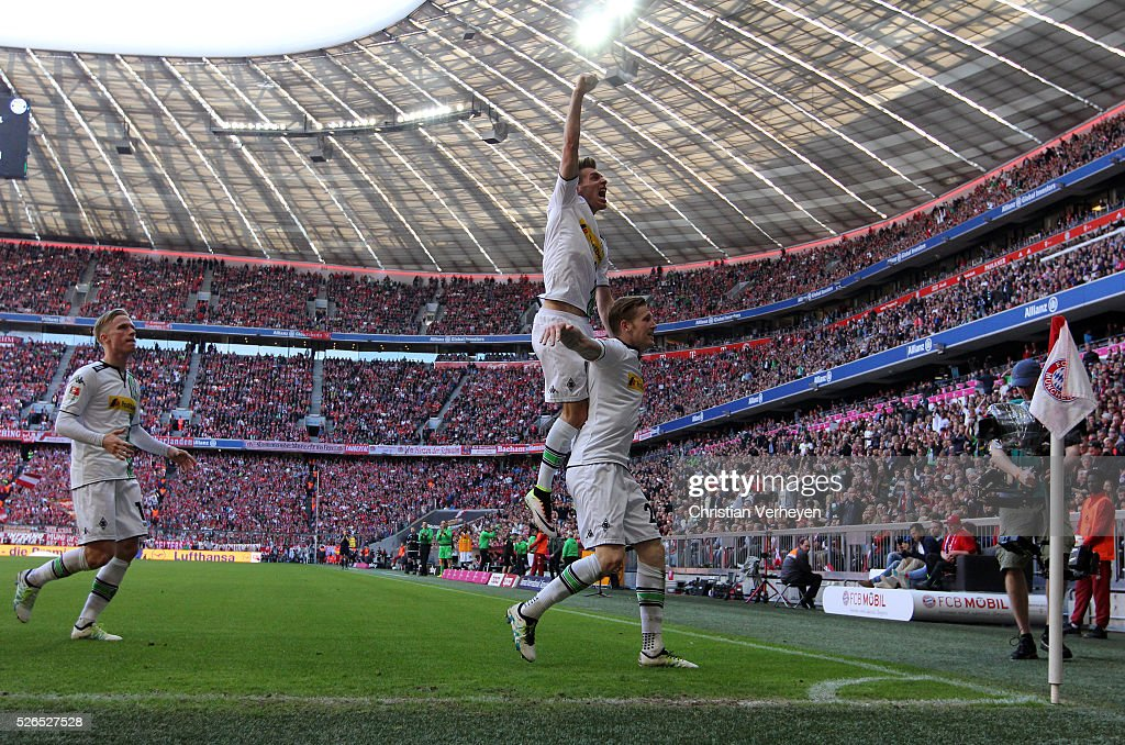 Andre Hahn of Borussia Moenchengladbach celebrate with Patrick Herrmann after he scores his teams first goal during the Bundesliga match between FC Bayern Muenchen and Borussia Moenchengladbach at Allianz Arena on April 30, 2016 in Moenchengladbach, Germany