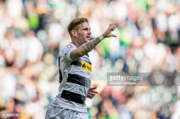 Andre Hahn of Borussia Moenchengladbach celebrates after scoring an equaliser during the Bundesliga Match between Borussia Moenchengladbach and FC...