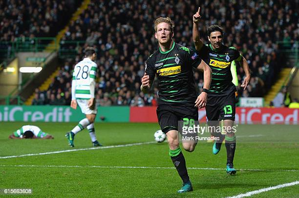 Andre Hahn of Borussia Moenchengladbach celebrates after scoring his team's second goal of the game during the UEFA Champions League group C match...