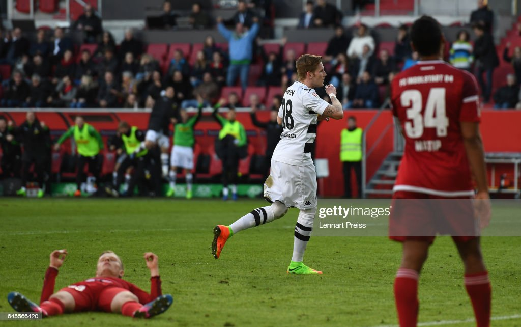 Andre Hahn (C) of Borussia Moenchengladbach celebrates his side's second goal during the Bundesliga match between FC Ingolstadt 04 and Borussia Moenchengladbach at Audi Sportpark on February 25, 2017 in Ingolstadt, Germany.