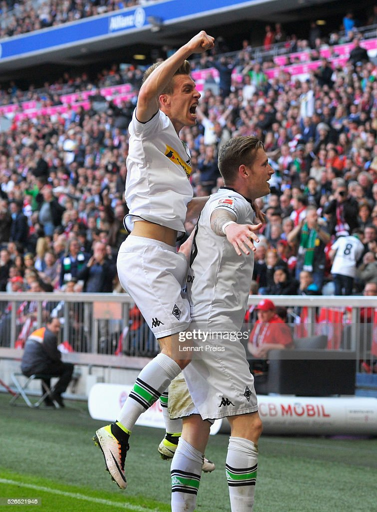 Andre Hahn (R) of Borussia Moenchengladbach celebrates scoring his team's first goal with his team mate Patrick Herrmann (L) during the Bundesliga match between Bayern Muenchen and Borussia Moenchengladbach at Allianz Arena on April 30, 2016 in Munich, Germany.