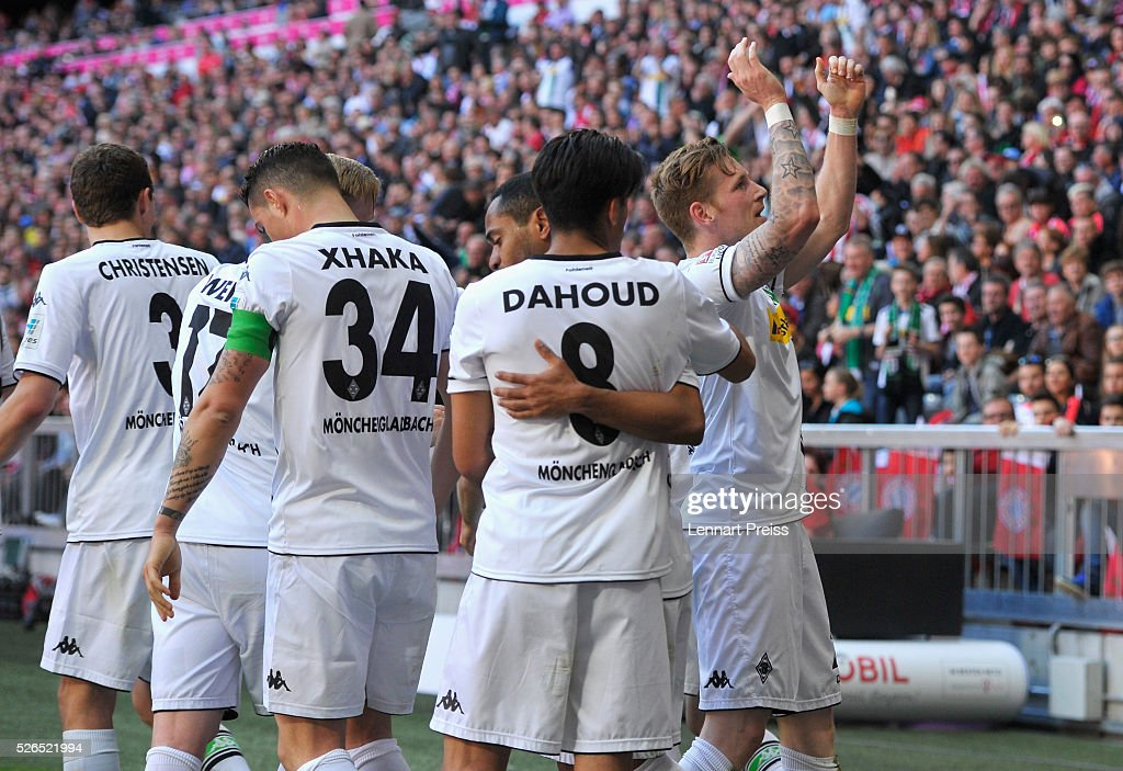 Andre Hahn (1st R) of Borussia Moenchengladbach celebrates scoring his team's first goal with his team mates during the Bundesliga match between Bayern Muenchen and Borussia Moenchengladbach at Allianz Arena on April 30, 2016 in Munich, Germany.