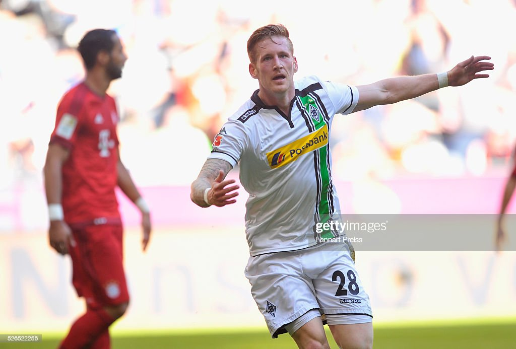 Andre Hahn of Borussia Moenchengladbach celebrates scoring his team's first goal during the Bundesliga match between Bayern Muenchen and Borussia Moenchengladbach at Allianz Arena on April 30, 2016 in Munich, Germany.