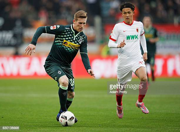 Andre Hahn of Borussia Moenchengladbach in action during the Bundesliga match between FC Augsburg and Borussia Moenchengladbach at WWK Arena on...