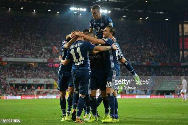 Andre Hahn of Hamburg and Filip Kostic of Hamburg celebrate with team mates after Hahn scored his teams first goal during the Bundesliga match...