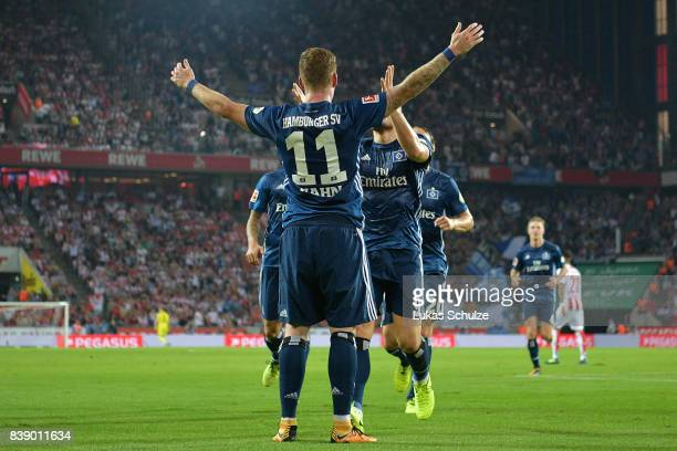 Andre Hahn of Hamburg celebrates with team mates after he scored his teams first goal during the Bundesliga match between 1 FC Koeln and Hamburger SV...