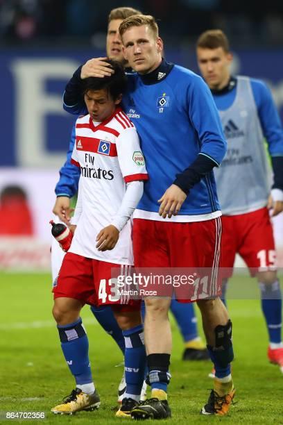 Andre Hahn of Hamburg embraces Tatsuya Ito of Hamburg after the Bundesliga match between Hamburger SV and FC Bayern Muenchen at Volksparkstadion on...