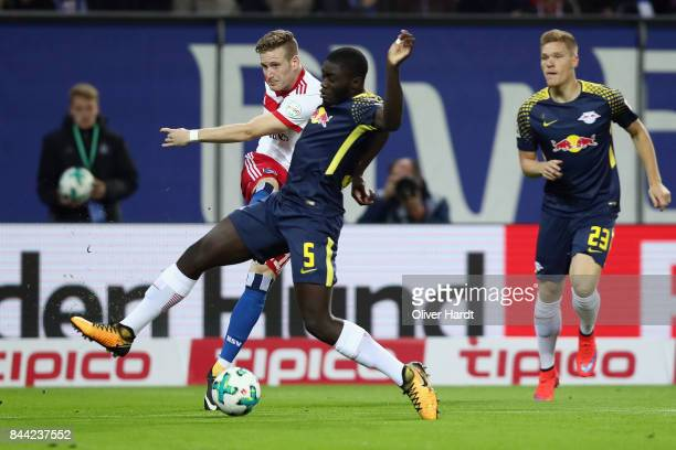 Andre Hahn of Hamburg is challenged by Dayot Upamecano of Leipzig during the Bundesliga match between Hamburger SV and RB Leipzig at Volksparkstadion...