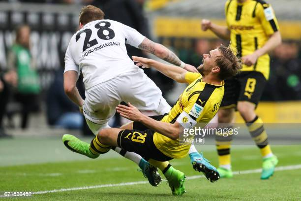 Andre Hahn of Moenchengladbach and Marcel Schmelzer of Dortmund battle for the ball during the Bundesliga match between Borussia Moenchengladbach and...