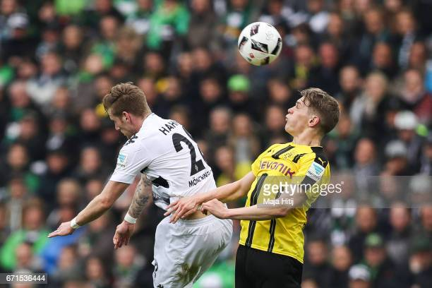 Andre Hahn of Moenchengladbach and Matthias Ginter of Dortmund battle for the ball during the Bundesliga match between Borussia Moenchengladbach and...