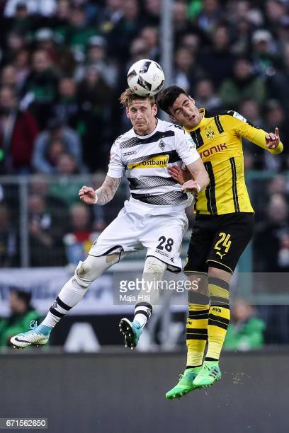 Andre Hahn of Moenchengladbach and Mikel Merino Zazon of Dortmund battle for the ball during the Bundesliga match between Borussia Moenchengladbach...