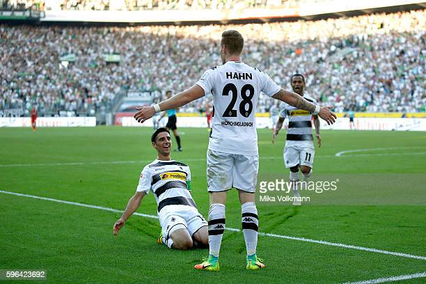 Andre Hahn of Moenchengladbach celebrates scoring the 10 goal with Lars Stindl of Moenchengladbach and Raffael of Moenchengladbach during the...