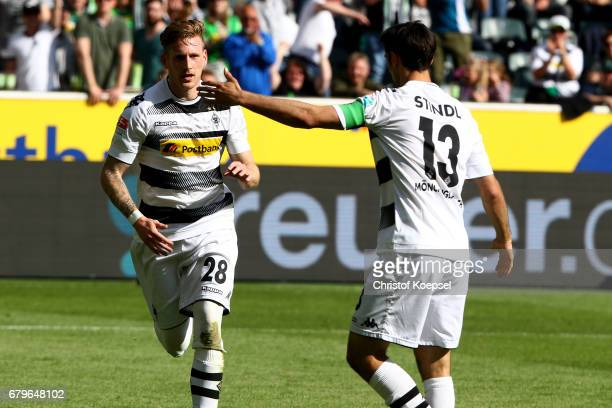 Andre Hahn of Moenchengladbach celebrates the first goal with Lars Stindl during the Bundesliga match between Borussia Moenchengladbach and FC...