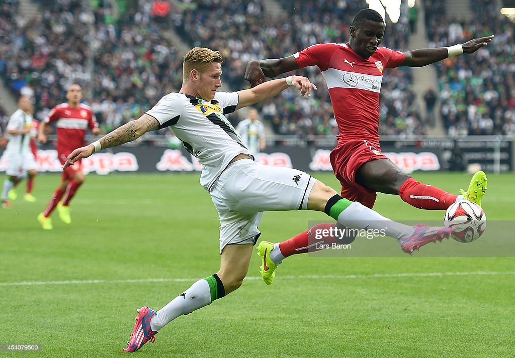 Andre Hahn of Moenchengladbach is challenged by Antonio Ruediger of Stuttgart during the Bundesliga match between Borussia Moenchengladbach and VfB Stuttgart at Borussia Park Stadium on August 24, 2014 in Moenchengladbach, Germany.