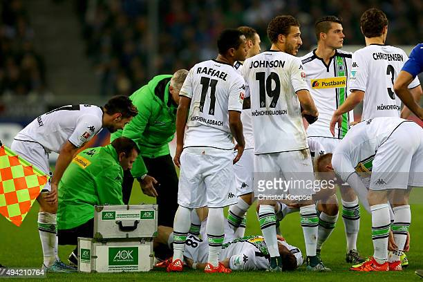 Andre Hahn of Moenchengladbach is treated after an injury during the Bundesliga match between Borussia Moenchengladbach and FC Schalke 04 at...