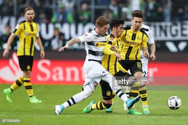 Andre Hahn of Moenchengladbach Mikel Merino Zazon of Dortmund and Raphael Guerreiro of Dortmund battle for the ball during the Bundesliga match...
