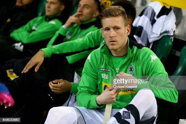 Andre Hahn of Moenchengladbach sits o he bench and binds his shies during the Bundesliga match between Borussia Moenchengladbach and FC Schalke 04 at...
