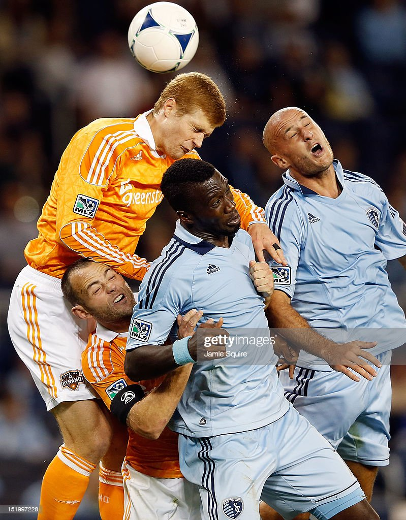 Andre Hainault #31 of the Houston Dynamo battles Brad Davis #11, <a gi-track='captionPersonalityLinkClicked' href=/galleries/search?phrase=C.J.+Sapong&family=editorial&specificpeople=7433612 ng-click='$event.stopPropagation()'>C.J. Sapong</a> #17, and Aurelien Collin #78 of Sporting KC for a header during the MLS game at Livestrong Sporting Park on September 14, 2012 in Kansas City, Kansas.