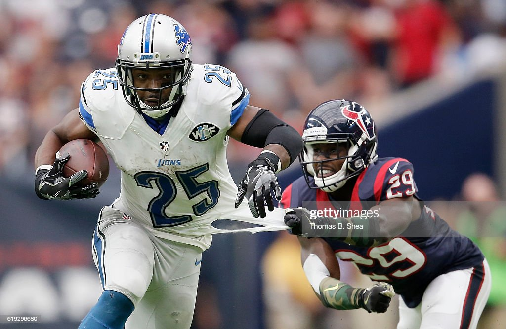 Andre Hal #29 of the Houston Texans grabs the jersey of Theo Riddick #25 of the Detroit Lions in the fourth quarter at NRG Stadium on October 30, 2016 in Houston, Texas.