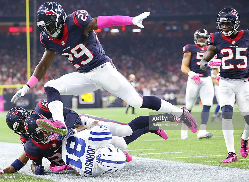 Andre Hal #29 of the Houston Texans jumps over a tackled Andre Johnson #81 of the Indianapolis Colts in the third quarter on October 8, 2015 at NRG Stadium in Houston, Texas.