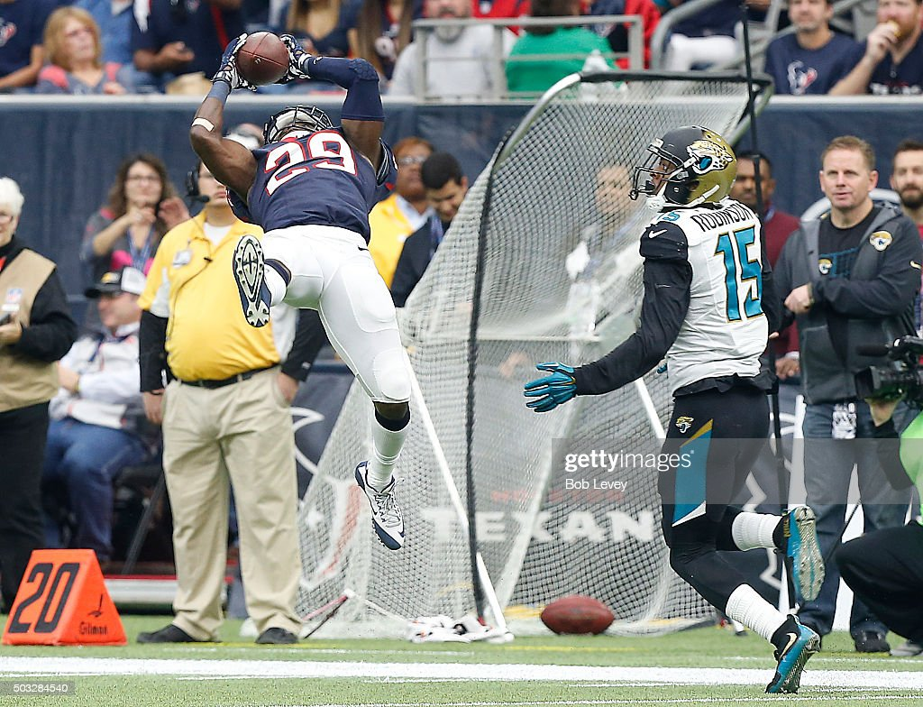 Andre Hal #29 of the Houston Texans makes a catch against the Allen Robinson #15 of the Jacksonville Jaguars in the second quarter on January 3, 2016 at NRG Stadium in Houston, Texas.