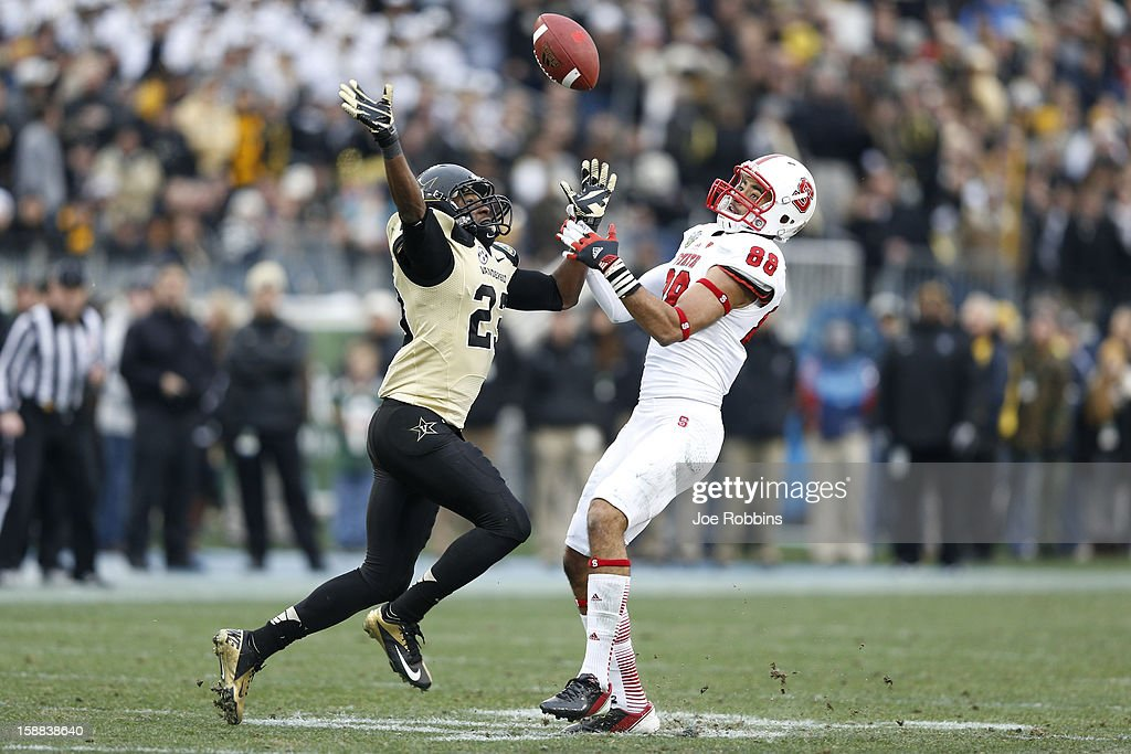 Andre Hall #23 of the Vanderbilt Commodores defenses a pass intended for Quintin Payton #88 of the North Carolina State Wolfpack during the Franklin American Mortgage Music City Bowl at LP Field on December 31, 2012 in Nashville, Tennessee. Vanderbilt won 38-24.