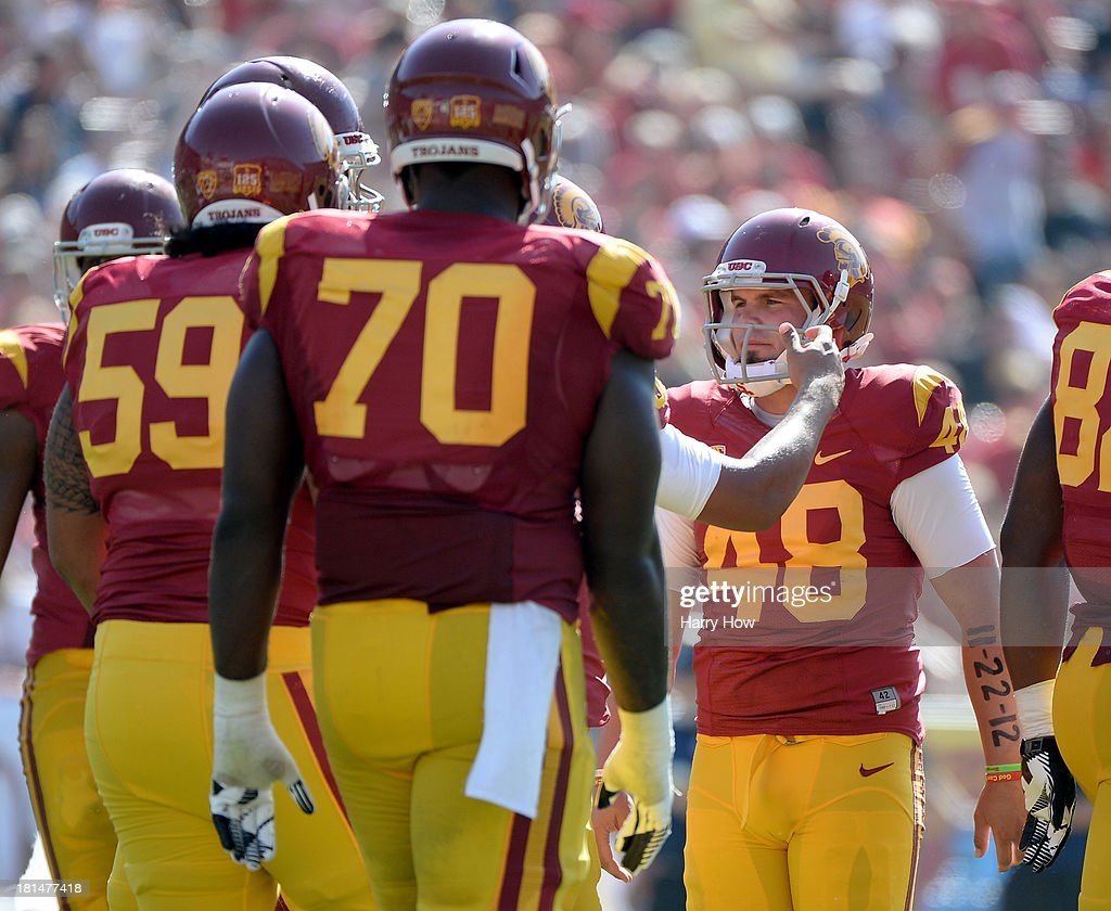 Andre Heidari #48 of the USC Trojans celebrates his field goal with teammates to take a 17-14 lead over the Utah State Aggies during the fourth quarter at the Los Angeles Memorial Coliseum on September 21, 2013 in Los Angeles, California.