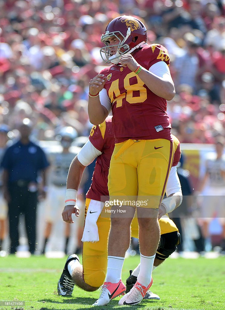 Andre Heidari #48 of the USC Trojans reacts to his field goal to take a 17-14 lead over the Utah State Aggies during the fourth quarter at the Los Angeles Memorial Coliseum on September 21, 2013 in Los Angeles, California. The Trojans won 17-14.