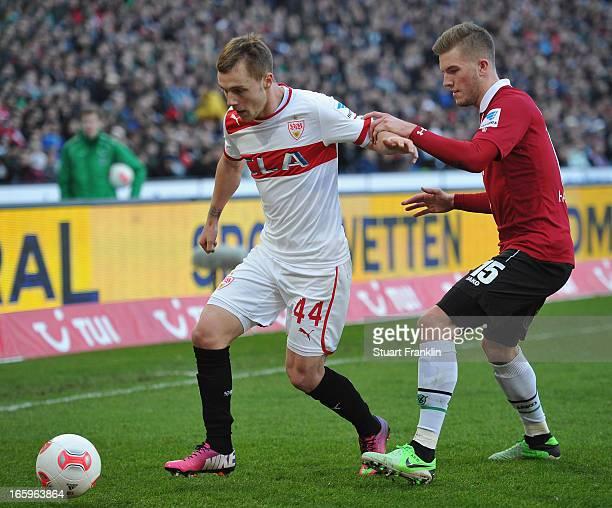 Andre Hoffmann of Hannover is challenged by Alexandru Maxim of Stuttgart during the Bundesliga match between Hannover 96 v VfB Stuttgart at AWD Arena...